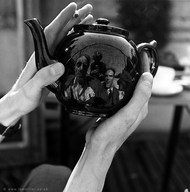 Lee Miller - Portrait of Leslie Hurry in a teapot, including Lee Miller and unknown man, Vale Lodge, Vale of Health, Hampstead, London, England, 1943