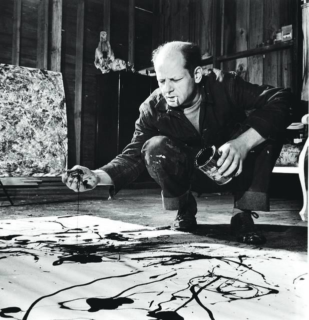 Martha Holmes - Jackson Pollock Dribbling Sand on Painting While Working in his Studio